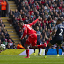 Liverpool's Daniel Sturridge, center, scores against Southampton during their English Premier League soccer match at Anfield Stadium, Liverpool, England, Sunday Aug. 17, 2014
