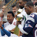 Former Boston Red Sox player Pedro Martinez, second from left, reacts while standing with Mike Lowell, left, Jason Varitek former Boston Celtics' Leon Powe, fourth from left, and former players from the New England Patriots during pre-game ceremonies befo