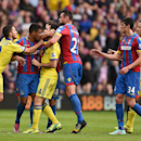 Chelsea's Cesc Fabregas, third left, confronts Crystal Palace's Fraizer Campbell, second left, after Chelsea's Cesar Azpilicueta was sent off during their English Premier League soccer match at Selhurst Park, London, Saturday, Oct. 18, 2014