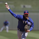 Texas Rangers' Tommy Hanson throws during the second inning of a spring exhibition baseball game against the Kansas City Royals, Saturday, March 22, 2014, in Surprise, Ariz The Associated Press
