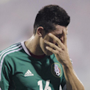 Mexico's Hector Herrera walks off the field after the team's 2-0 loss to the United States in a World Cup qualifying soccer match Tuesday, Sept. 10, 2013, in Columbus, Ohio. (AP Photo/Jay LaPrete)