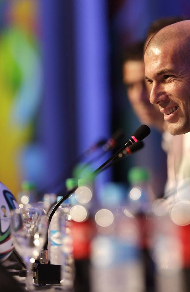 Former soccer great and World Cup winner Zinedine Zidane of France smiles during a press conference one day before the draw for the 2014 soccer World Cup in Costa do Sauipe near Salvador, Brazil, Thursday, Dec. 5, 2013
