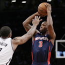 Brooklyn Nets guard Joe Johnson (7) defends Detroit Pistons guard Rodney Stuckey (3) in the second half of an NBA basketball game, Sunday, Nov. 24, 2013, in New York. Stuckey scored a season-high 27 points as the Pistons sent the Nets into last place in t