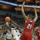 Louisville's Chris Jones, left, is fouled by Louisiana Lafayette's Shawn Long during the second half of an NCAA college basketball game Saturday Dec. 7, 2013, in Louisville, Ky. Louisville defeated Louisiana Lafayette 113-74. (AP Photo/Timothy D. Easley)