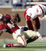 Boston College running back Andre Williams (44) slips on the turf while rushing against North Carolina State cornerback Juston Burris (11) in the first quarter of an NCAA college football game in Boston, Saturday, Nov. 16, 2013. (AP Photo/Michael Dwyer)