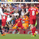 Tottenham's Younes Kaboul, centre left, scores an own goal during his team's English Premier League soccer match against Liverpool's at Anfield Stadium, Liverpool, England, Sunday March 30, 2014
