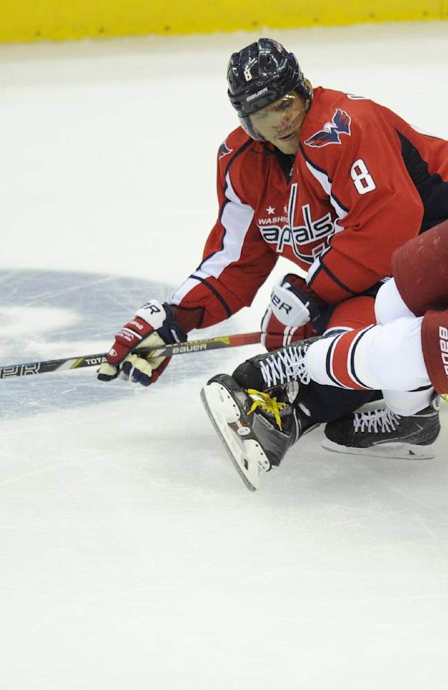 Washington Capitals right wing Alex Ovechkin (8), of Russia, battles for the puck against Carolina Hurricanes center Eric Staal (12) during the third period an NHL hockey game, Thursday, Oct. 10, 2013, in Washington. The Hurricanes won 3-2