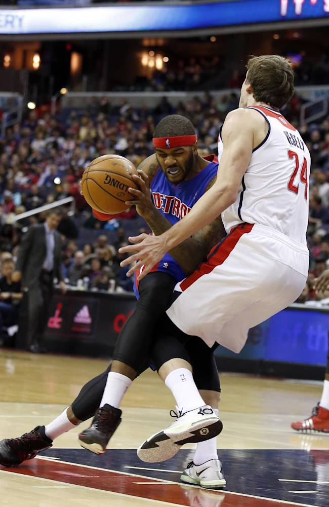 Detroit Pistons forward Josh Smith (6) is fouled by Washington Wizards forward Jan Vesely (24), from the Czech Republic, in the first half of an NBA basketball game, Saturday, Jan. 18, 2014, in Washington
