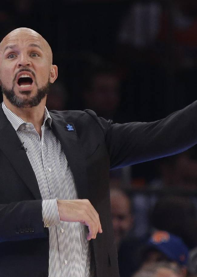 Brooklyn Nets head coach Jason Kidd calls out to his team during the first half of an NBA basketball game against the New York Knicks Wednesday, April 2, 2014, in New York