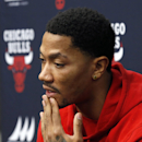 Chicago Bulls guard Derrick Rose responds to a question about his injured knee during an NBA basketba news conference at the United Center Thursday, Dec. 5, 2013, in Chicago The Associated Press