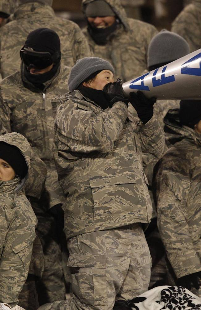 Bundled against single-digit temperatures, cadets Air Fore cadets cheer as Air Force hosts UNLV in the third quarter of an NCAA football game at Air Force Academy, Colo., on Thursday, Nov. 21, 2013