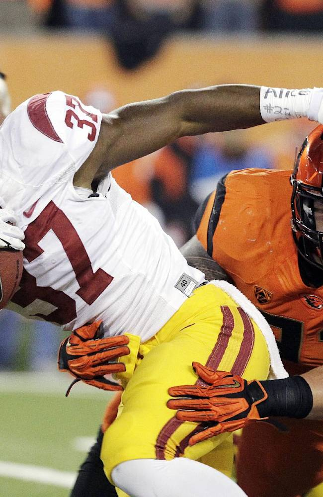 Allen runs for 3 TDs, USC tops Oregon State 31-14