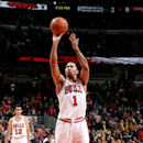 CHICAGO, IL - OCTOBER 19: Derrick Rose #1 of the Chicago Bulls attempts a free throw against the Charlotte Hornets on October 19, 2014 at United Center, Chicago, Illinois. (Photo by Gary Dineen/NBAE via Getty Images)