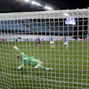 CSKA's Bebras Natcho, right, scores a penalty goal against Manchester City's goalkeeper Joe Hart, left, during the Group E Champions League match between CSKA Moscow and Manchester City at Arena Khimki stadium in Moscow, Russia, Tuesday, Oct. 21, 2014