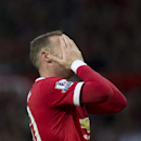 Manchester United's Wayne Rooney reacts after a missed opportunity during his team's pre season friendly soccer match against Valencia at Old Trafford Stadium, Manchester, England, Tuesday Aug. 12, 2014