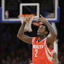 Houston Rockets' Patrick Beverley celebrates after making a 3-point basket during the first half of an NBA basketball game against the New York Knicks on Thursday, Nov. 14, 2013, in New York The Associated Press
