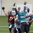 Miami Dolphins quarterback Ryan Tannehill (17) passes during NFL football training camp in Davie, Fla., Saturday, July 26, 2014 The Associated Press