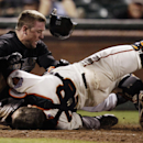In this May 25, 2011, file photo, Florida Marlins' Scott Cousins, top, collides with San Francisco Giants catcher Buster Posey on a fly ball hit by Marlins' Emilio Bonifacio during the 12th inning of a baseball game in San Francisco. New York Mets general