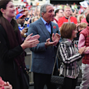 Atlanta Falcons owner Arthur Blank, center, applauds during the NFL Fan Rally in Trafalgar Square, London, England, Saturday, Oct. 25, 2014. The Atlanta Falcons will play the Detroit Lions in an NFL football game at London's Wembley Stadium on Sunday Oct.