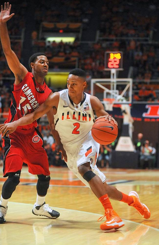 Illinois guard Joseph Bertrand (2) drives past Jacksonville State guard Grant White during the first half of an NCAA college basketball game Sunday, Nov. 10, 2013, in Champaign, Ill