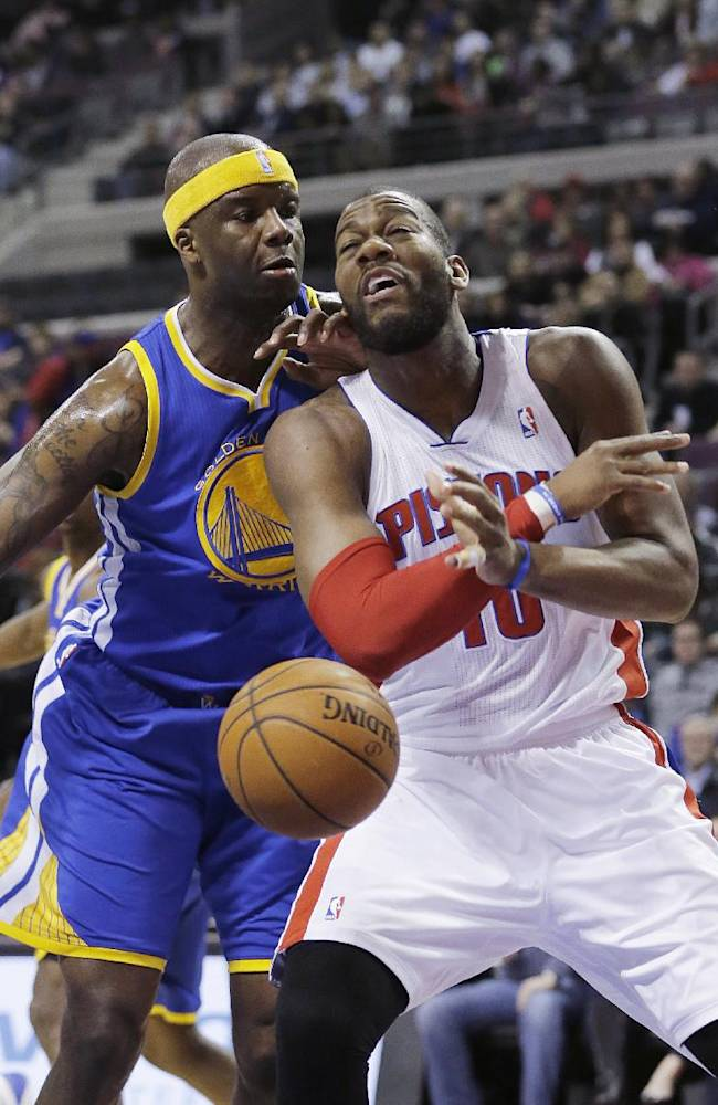 Detroit Pistons forward Greg Monroe (10) is fouled by Golden State Warriors center Jermaine O'Neal (7) during the first half of an NBA basketball game in Auburn Hills, Mich., Monday, Feb. 24, 2014