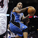 Orlando Magic point guard Jameer Nelson (14) looks to pass as he goes up in the lane against the Atlanta Hawks during the second half of an NBA basketball game on Tuesday, Nov. 26, 2013, in Atlanta. Orlando won 109-92 The Associated Press