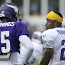Minnesota Vikings cornerback Captain Munnerlyn, right, talks with wide receiver Greg Jennings during an NFL football training camp practice, Wednesday, July 30, 2014, in Mankato, Minn The Associated Press