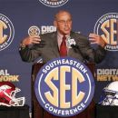 Arkansas coach John L. Smith speaks to the media at the Southeastern Conference NCAA college football media day in Hoover, Ala. on Wednesday, July 18 , 2012. (AP Photo/Butch Dill)