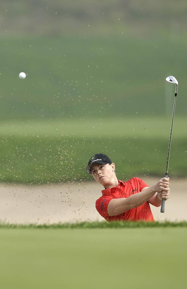 Christel Boeljon of the Netherlands hits out of a bunker on the third hole during the second round of the Reignwood LPGA Classic golf tournament at Pine Valley Golf Club on the outskirts of Beijing, China, Friday, Oct. 4, 2013