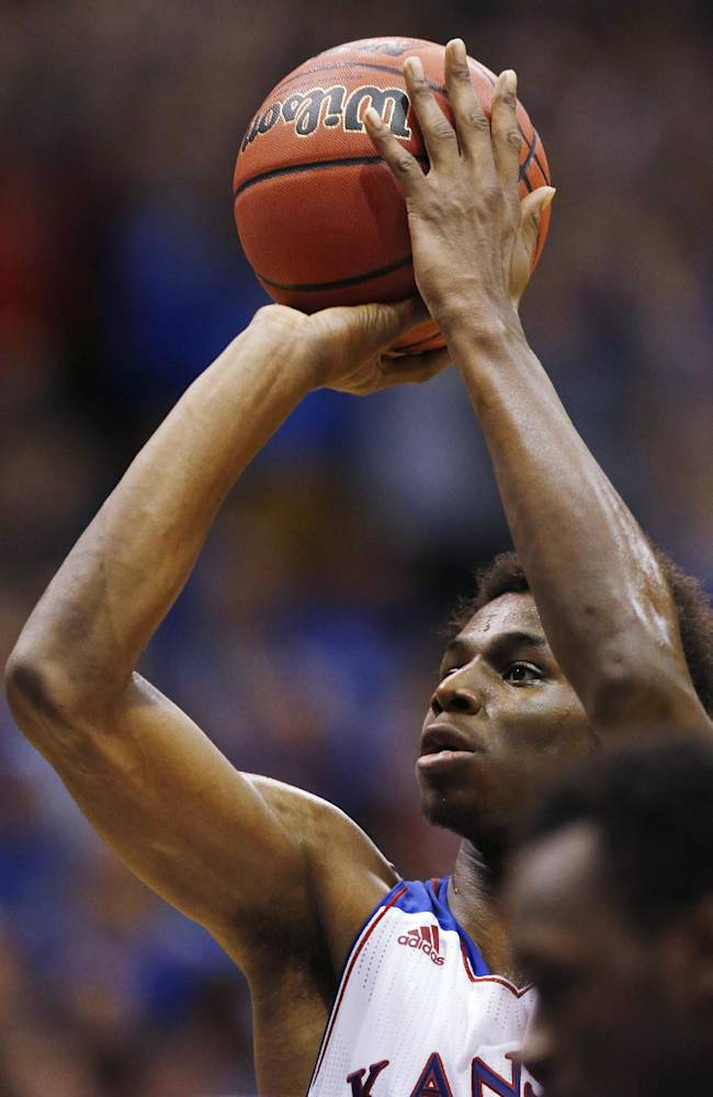Kansas guard Andrew Wiggins shoots a free throw during the first half of an exhibition NCAA college basketball game against Pittsburg State in Lawrence, Kan., Tuesday, Oct. 29, 2013. Wiggins scored 16 points as Kansas won 97-57