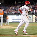 Philadelphia Phillies' Tony Gwynn Jr., walks home after Miami Marlins' Jose Fernandez walked Ryan Howard with the bases loaded during the third inning of a baseball game on Friday, April 11, 2014, in Philadelphia The Associated Press