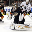 Anaheim Ducks goalie John Gibson, center, stops a shot during the first period of an NHL hockey game against the Los Angeles Kings, Friday, Feb. 27, 2015, in Anaheim, Calif. (AP Photo/Jae C. Hong)