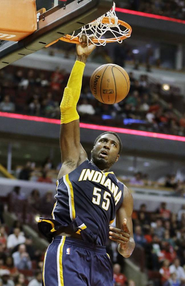 Indiana Pacers center Roy Hibbert (55) dunks against the Chicago Bulls during the second half of an NBA preseason basketball game in Chicago on Friday, Oct. 18, 2013. the Bulls won 103-98