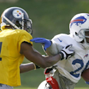 Buffalo Bills running back C.J. Spiller (28), runs away from Pittsburgh Steelers cornerback Ike Taylor (24) during a combined NFL football training camp session in Latrobe, Pa. on Wednesday, Aug. 13, 2014 The Associated Press