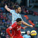 West Ham United's Andy Carroll, top, and Liverpool's Emre Can battle for the ball during their English Premier League soccer match at Anfield, Liverpool, England, Saturday, Jan. 31, 2015
