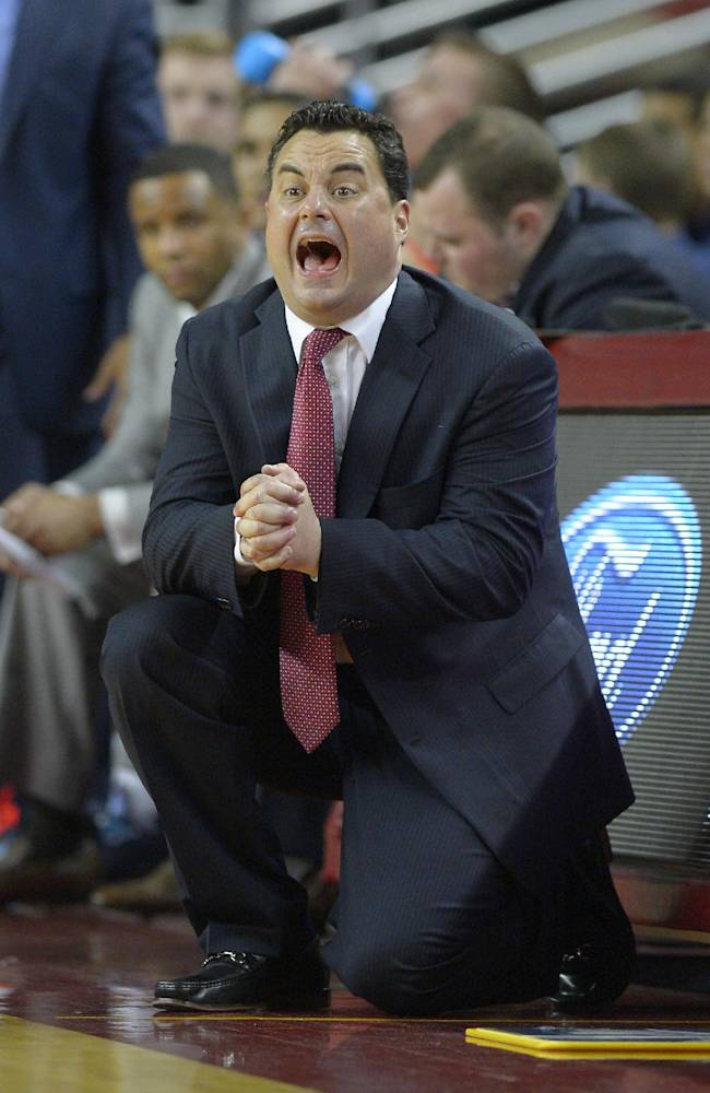 Arizona head coach Sean Miller yells to his team during the second half of an NCAA college basketball game against Southern California, Sunday, Jan. 12, 2014, in Los Angeles