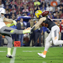 Green Bay Packers' Clay Matthews attempts to block a punt by Indianapolis Colts' Pat McAfee during the second half of the NFL Football Pro Bowl Sunday, Jan. 25, 2015, in Glendale, Ariz The Associated Press
