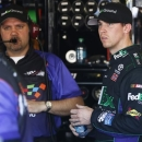 Denny Hamlin, right, meets with crew chief Darian Grubb in the team garage during practice for the NASCAR Sprint Cup Series auto race Saturday, March 2, 2013, in Avondale, Ariz.(AP Photo/Ross D. Franklin)