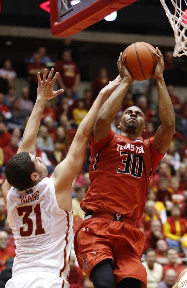 Texas Tech forward Jaye Crockett puts up a shot over Iowa State forward Georges Niang during the second half of an NCAA college basketball game at Hilton Coliseum in Ames, Iowa, Saturday, Feb. 15, 2014. Iowa State won the game 70-64