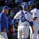 Chicago Cubs manager Rick Renteria, left, walks to the mound to remove relief pitcher James Russell, right, during the eighth inning of a baseball game against the Philadelphia Phillies in Chicago, Saturday, April 5, 2014 The Associated Press