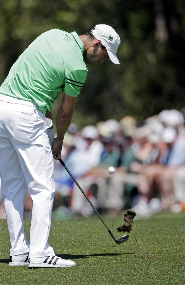 Martin Kaymer, of Germany, hits off the third fairway during the fourth round of the Masters golf tournament Sunday, April 13, 2014, in Augusta, Ga