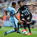 Manchester City's Gael Clichy, left, vies for the ball with Newcastle United's Remy Cabella, right, during their English Premier League soccer match at St James' Park, Newcastle, England, Sunday, Aug. 17, 2014