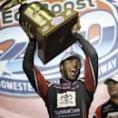 Darrell Wallace Jr. celebrates after winning the NASCAR Trucks series auto race, Friday, Nov. 14, 2014, in Homestead, Fla. (AP Photo/J Pat Carter)