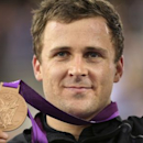 New Zealand's Simon van Velthooven stands on the podium with his bronze medal during the victory ceremony for the track cycling men's keirin event at the Velodrome during the London 2012 Olympic Games August 7, 2012.         REUTERS/Stefano Rellandini