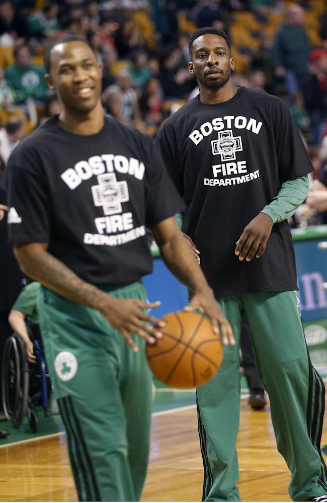 Boston Celtics's Jeff Green, right, wears a Boston Fire Department t-shirt with teammates before an NBA basketball game against the Chicago Bulls in Boston, Sunday, March 30, 2014