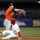 Philadelphia Phillies' Jimmy Rollins, bottom, is out as Miami Marlins' Derek Dietrich throws to first during the first inning of a baseball game on Friday, April 11, 2014, in Philadelphia The Associated Press