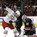 Carolina Hurricanes goalie Cam Ward (30) stops a shot by Columbus Blue Jackets' Boone Jenner during the first period of an NHL hockey game in Raleigh, N.C., Friday, Nov. 7, 2014. Carolina won 3-2 in overtime The Associated Press