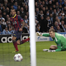 Barcelona's Daniel Alves scores his side's first goal next to Manchester City's goalkeeper Joe Hart during their Champions League first knock out round soccer match at the Etihad Stadium, Manchester, England, Tuesday Feb. 18, 2014