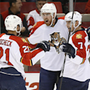 Florida Panthers right wing Jimmy Hayes, center, celebrates his goal against the Detroit Red Wings with Vincent Trocheck (21) and Dmitry Kulikov (7) in the first period during an NHL hockey game in Detroit Tuesday, Dec. 2, 2014 The Associated Press