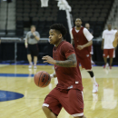 Arkansas guard Anton Beard moves the ball during a scrimmage at practice for an NCAA college basketball second-round game, Wednesday, March 18, 2015, in Jacksonville, Fla. Arkansas is to play Wofford on Thursday. (AP Photo/John Raoux)